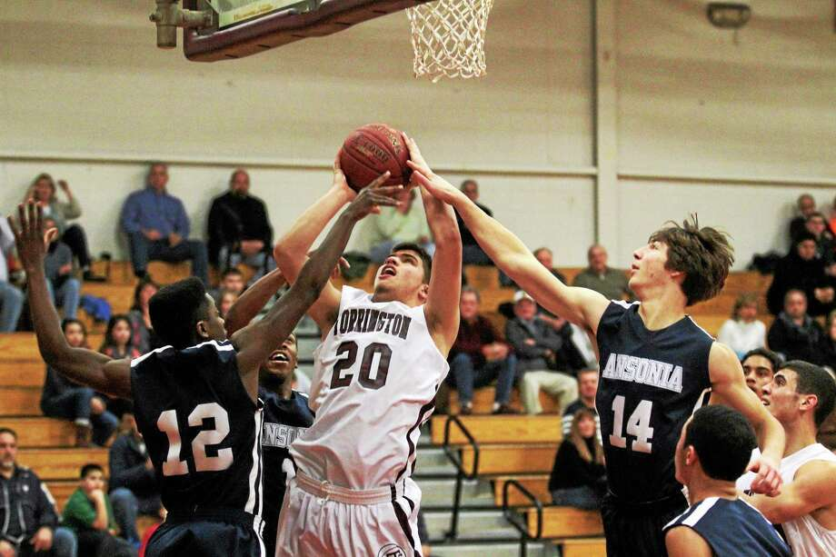 Torrington's Dom Sabia puts back a rebound in the Red Raiders 55-52 win over Ansonia. Photo: Marianne Killackey — Special To The Register Citizen  / 2013