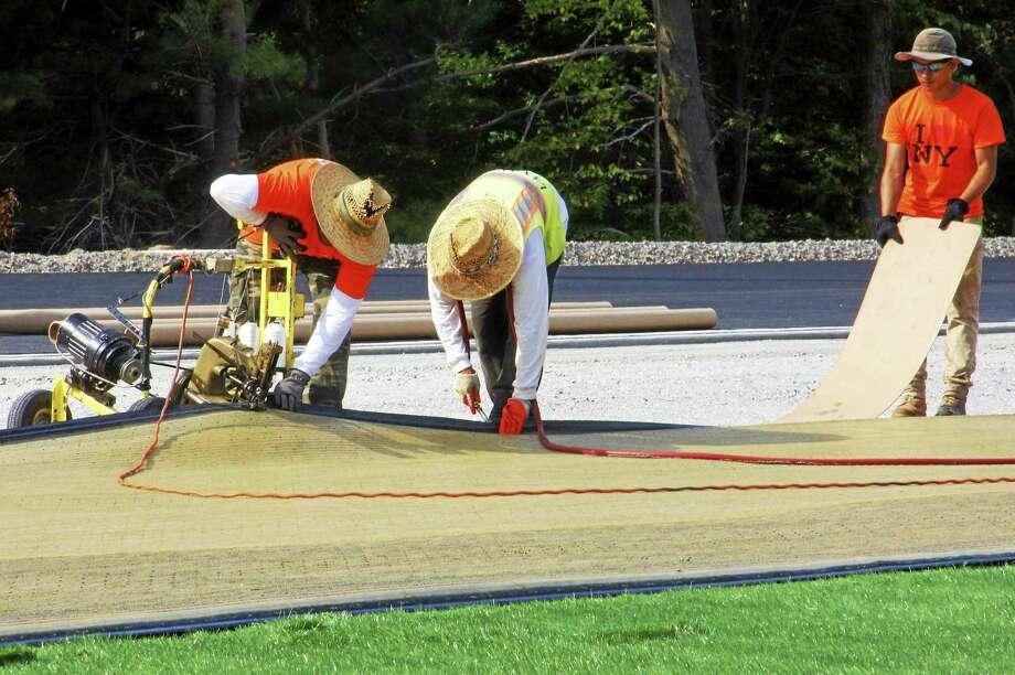 Torrington High School's athletic fields take shape as turf is installed on Friday, Sept. 5. Photo: Esteban L. Hernandez — The Register Citizen