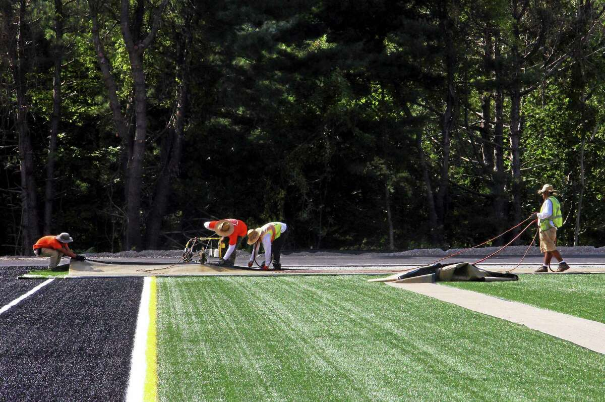 Torrington High School's athletic fields take shape as turf is installed on Friday, Sept. 5.
