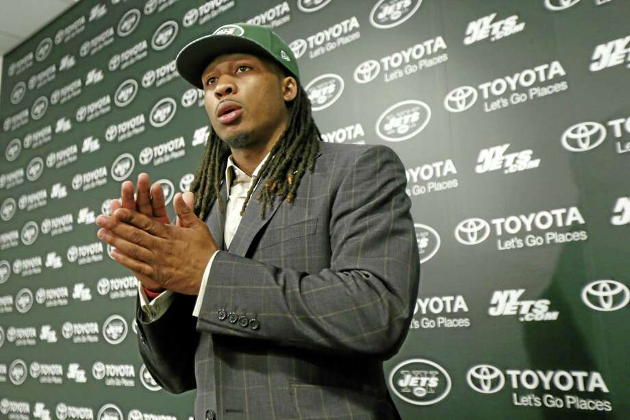 Calvin Pryor, who was drafted by the New York Jets with the 18th pick in the first round of the NFL draft on Thursday, waits for instructions after a news conference on Friday in Florham Park, N.J. Photo: Julio Cortez — The Associated Press  / AP