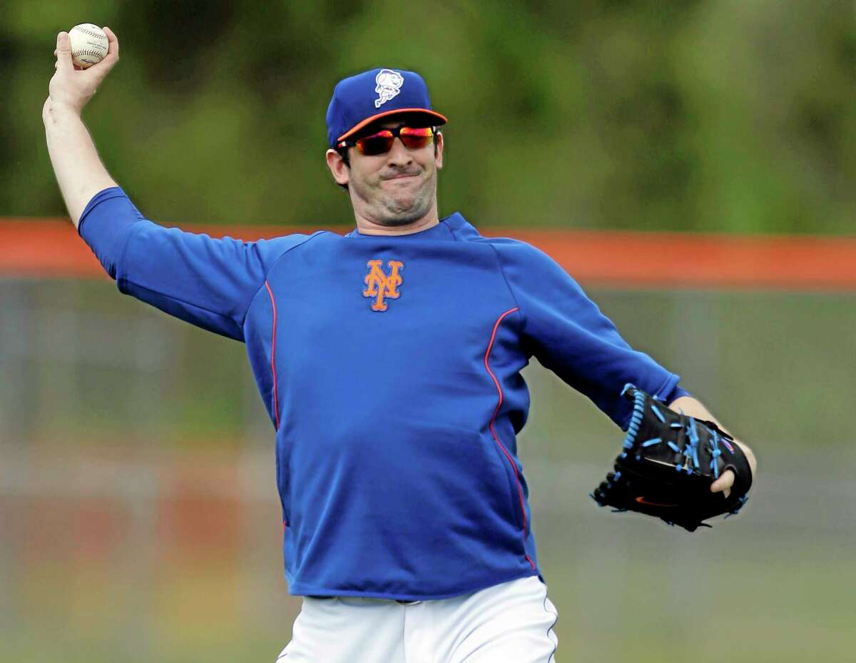In this Feb. 22 file photo, New York Mets pitcher Matt Harvey plays catch during practice in Port St. Lucie, Fla.