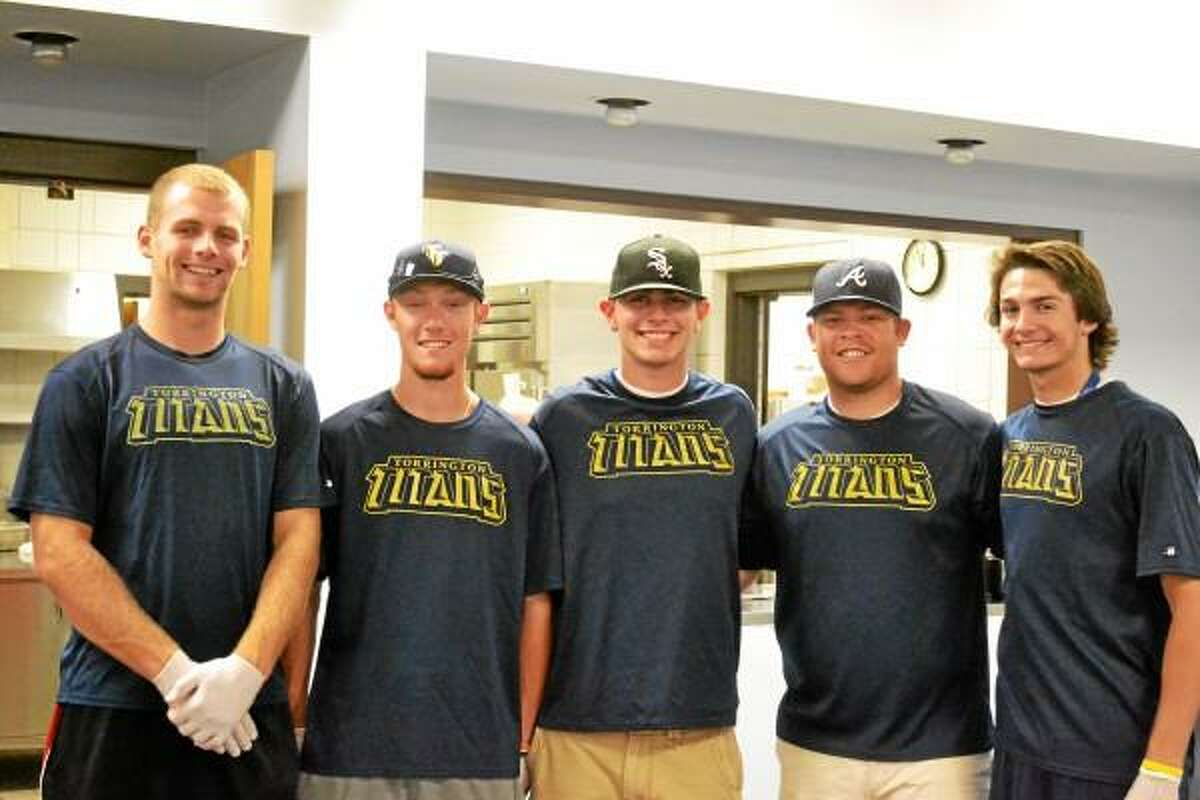 Titans players, Michael Odenwaelder, Kyle Decker, David Lerro, Stephen Eldridge and Bradley Keith went to the Sullivan Senior Center to hand out, and have, lunch with the members of the Sullivan Senior Center. Pete Paguaga-Register Citizen