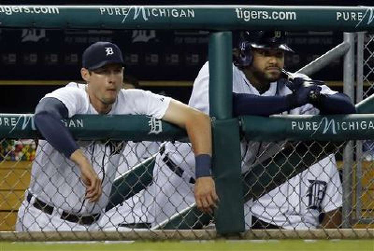 Detroit Tigers' Don Kelly, left, and Prince Fielder watch from the dugout during the ninth inning of a 10-6 loss to the Boston Red Sox in a baseball game on Friday, June 21, 2013 in Detroit. (AP Photo/Duane Burleson)