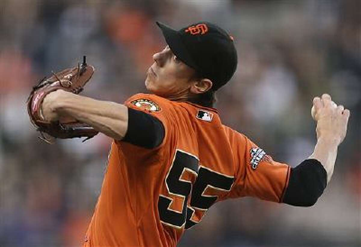 FILE - In this May 24, 2013, file photo, San Francisco Giants' Tim Lincecum works against the Colorado Rockies in the first inning of a baseball game in San Francisco. Lincecum is staying put with the Giants just as he hoped, reaching agreement Tuesday, OCt. 22, 2013, on a $35 million, two-year contract through the 2015 season. The deal is pending a physical, which hadn't been set. (AP Photo/Ben Margot, File)