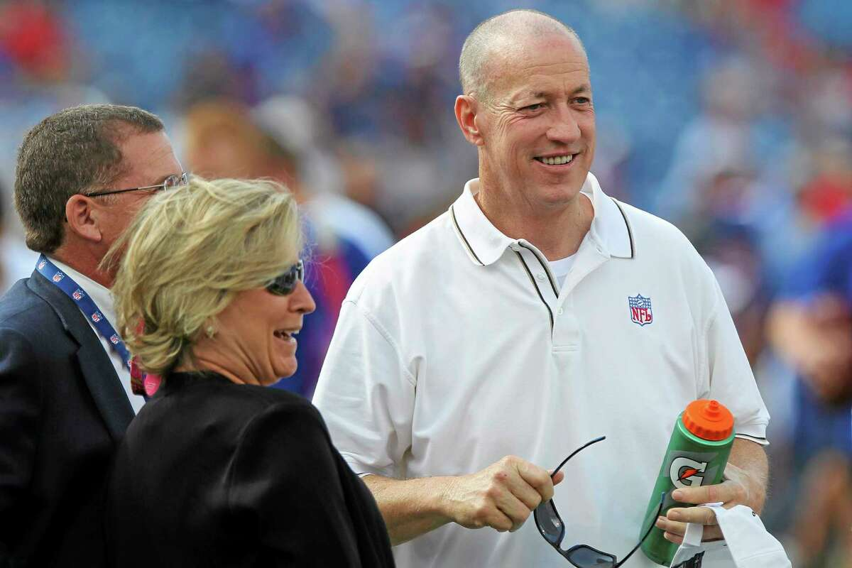 Former Buffalo Bills quarterback Jim Kelly, right, talks with Mary Wilson, wife of the late Bills owner Ralph Wilson, center, before a preseason game on Aug. 23 in Orchard Park, N.Y.