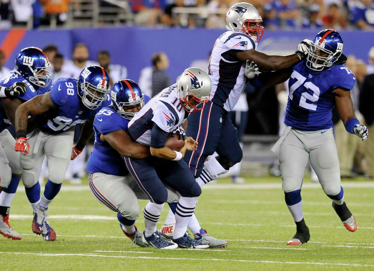The Giants' Mike Patterson, third from left, sacks New England Patriots quarterback Jimmy Garoppolo during a preseason game on Aug. 28 in East Rutherford, N.J.