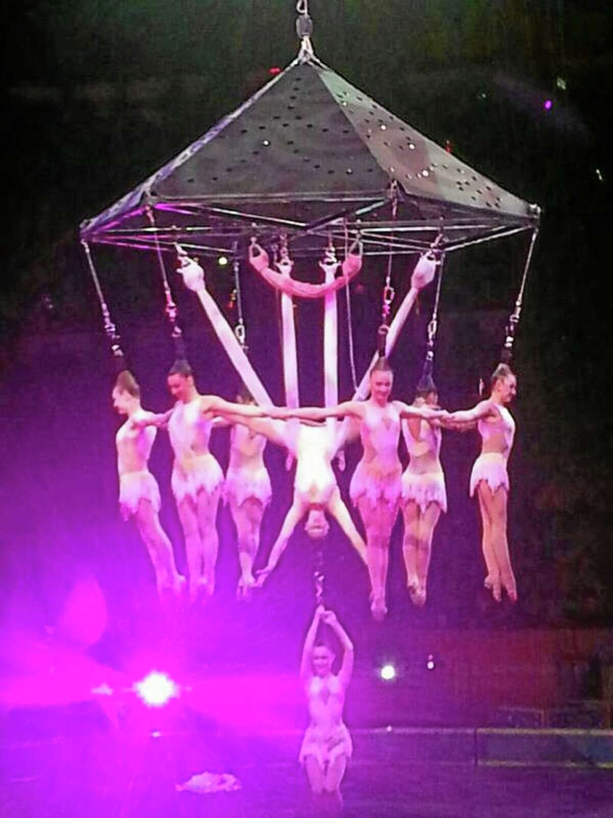 In this photo provided by Frank Caprio, performers hang during an aerial hair-hanging stunt at the Ringling Brothers and Barnum and Bailey Circus, Friday, May 2, 2014, in Providence, R.I. A platform collapsed during an aerial hair-hanging stunt at the 11 a.m. performance Sunday, May 4, sending eight acrobats plummeting to the ground. At least nine performers were seriously injured in the fall, including a dancer below, while an unknown number of others suffered minor injuries.