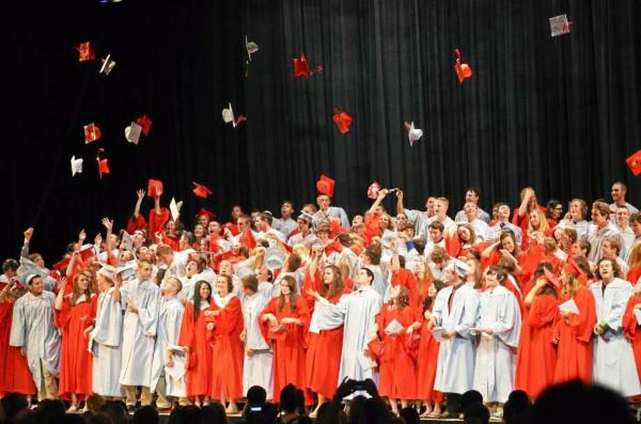 Graduates of the 2013 class of Northwestern Regional High School celebrate after diplomas were handed out at the Warner Theater in Torrington on Wednesday. John Berry - Register Citizen