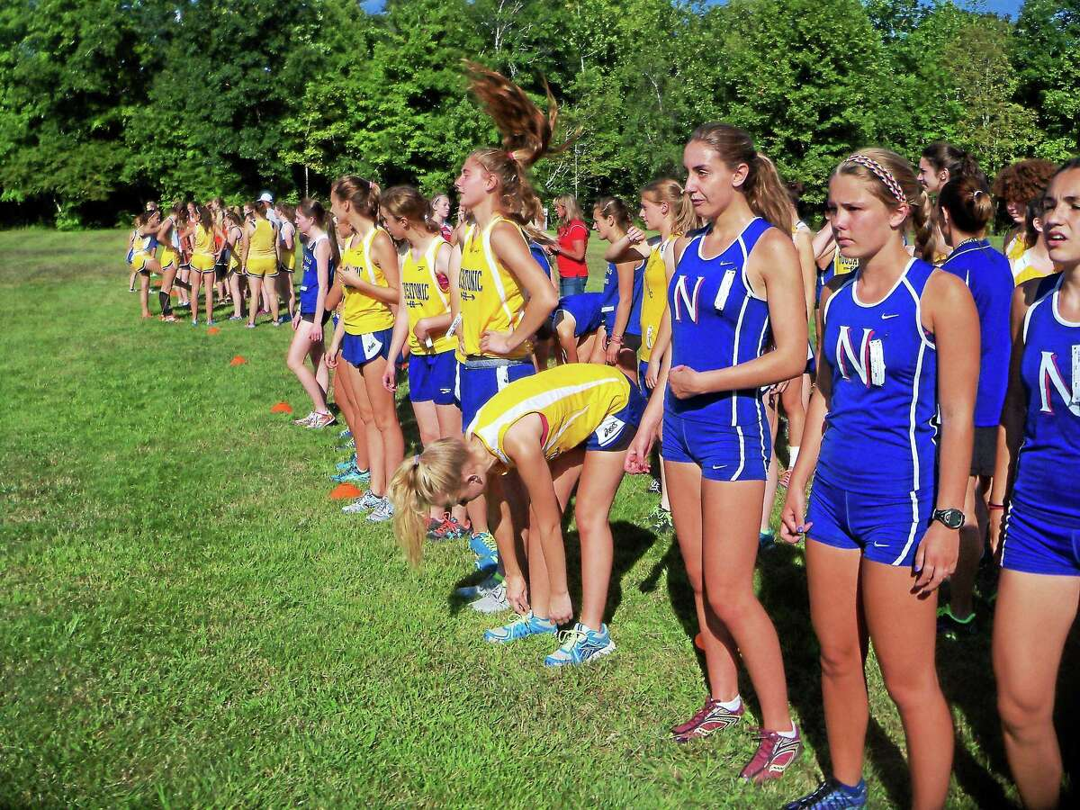 Members of the Nonnewaug and Housatonic girls cross country team line up before the start of the Berkshire League pre-season scrimmage meet at Black Rock State Park.
