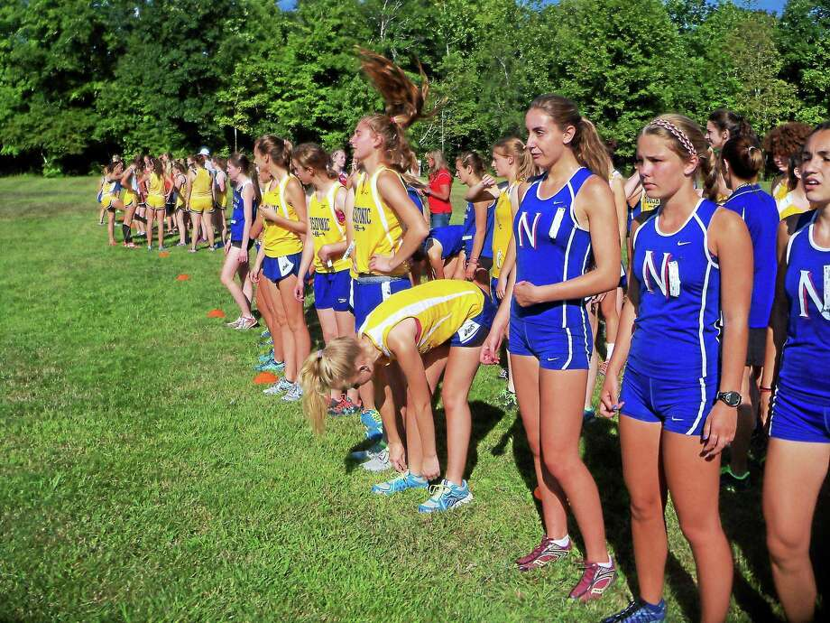 Members of the Nonnewaug and Housatonic girls cross country team line up before the start of the Berkshire League pre-season scrimmage meet at Black Rock State Park. Photo: Peter Wallace — Register Citizen