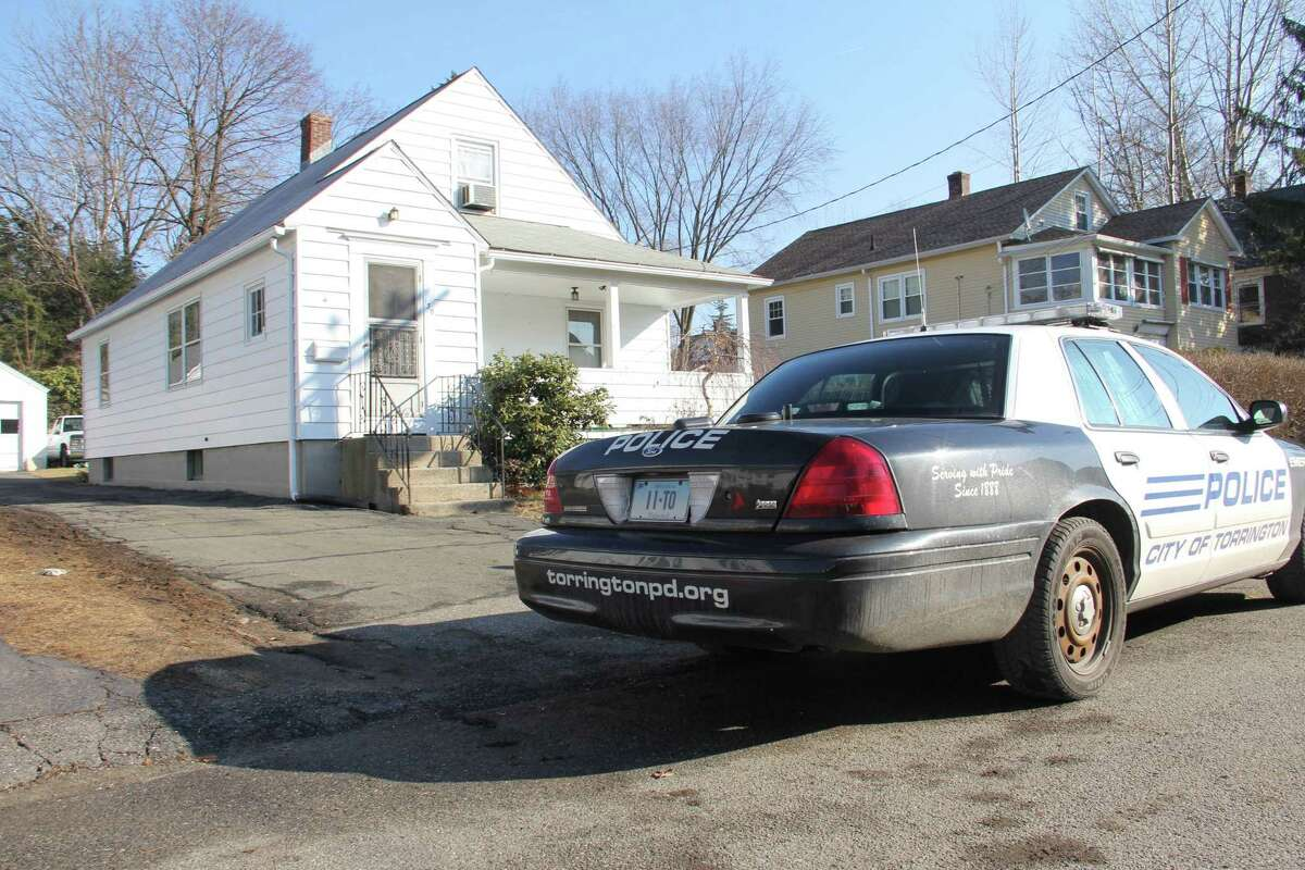 Torrington police respond to the scene of a home where shots were fired at 130 Berry St. in Torrington Friday.