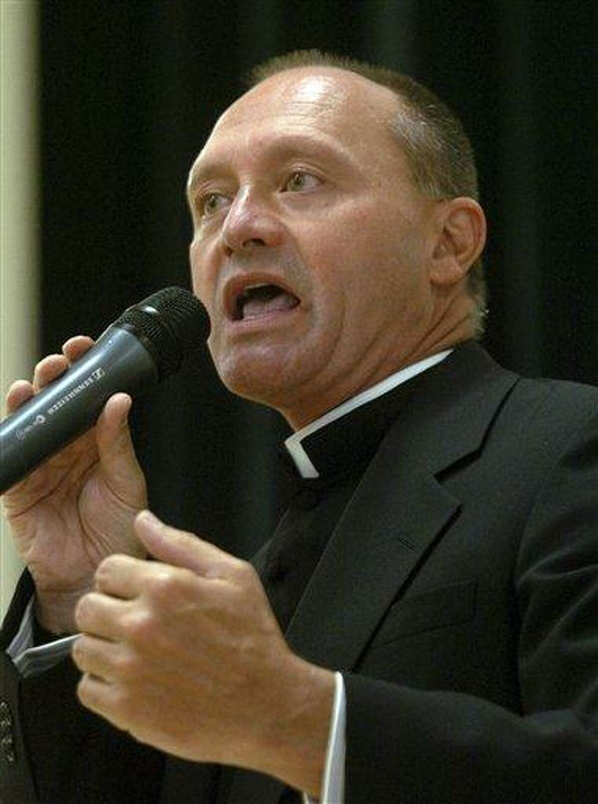 In this May 4, 2006 photo, Monsignor Kevin Wallin speaks at the Catholic Center, headquarters of the Diocese of Bridgeport, in Bridgeport, Conn. Wallin, of Waterbury, Conn., awaits a March 2013 trial on federal charges of shipping methamphetamine from California to his apartment and making more than $300,000 in drug sales in the second half of 2012. He was one of five people arrested and indicted by a grand jury in January 2013. (AP Photo/Connecticut Post)