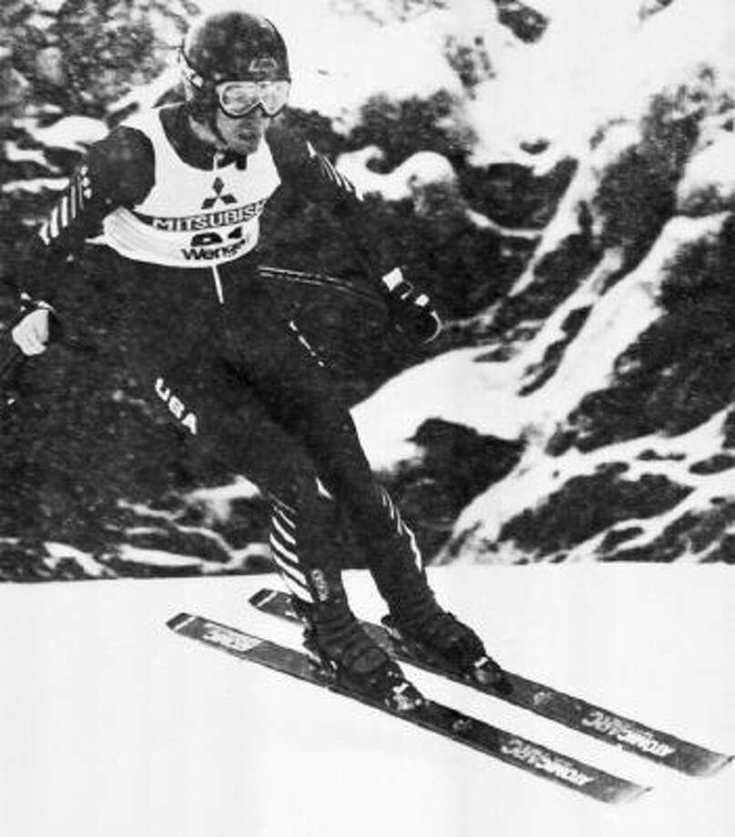In this Sunday, Jan. 15, 1984 file photo, Bill Johnson of Van Nuys, Calif. makes his way down the Lauberhorn course in the World Cup Mens Downhill Race, Wengen, Switzerland.