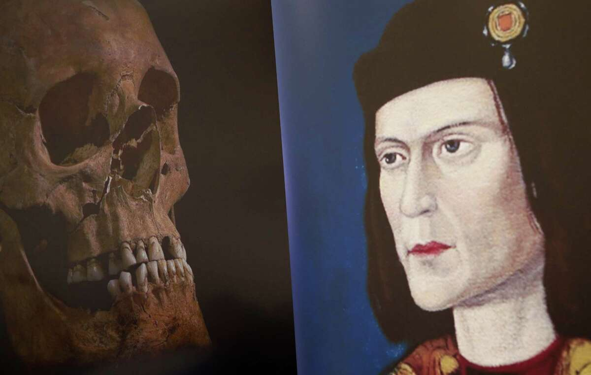 A television image of King Richard III's skull is seen next to a portrait of him during a news conference in Leicester, central England Feb. 4, 2013. (Darren Staples/Reuters)