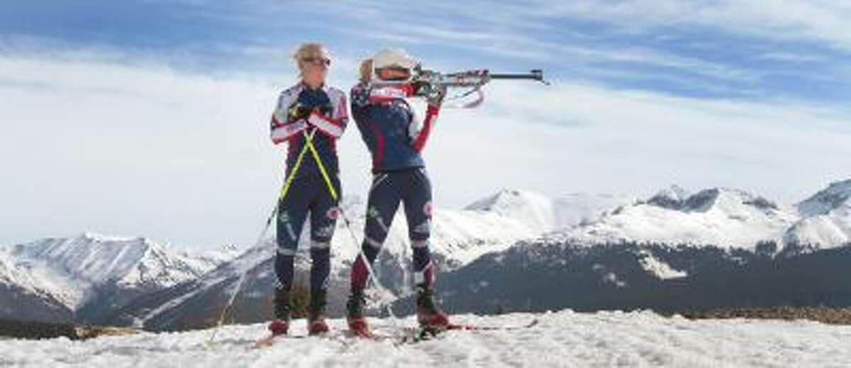 This file photo shows Tracy Barnes, left, watching her twin sister Lanny Barnes take aim near Molas Pass after a morning workout.