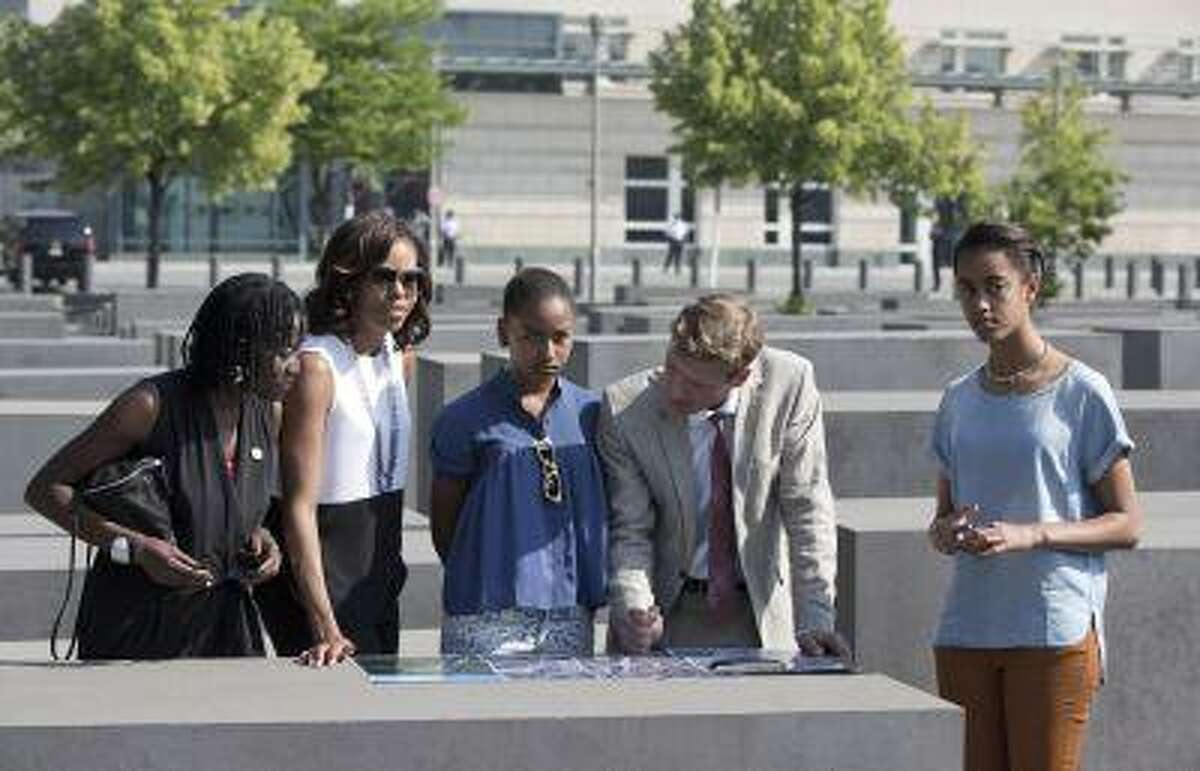 U.S. first lady Michelle Obama, her husband's half sister Auma Obama and her daughters Sasha and Malia visit the Holocaust Memorial in Berlin June 19, 2013.