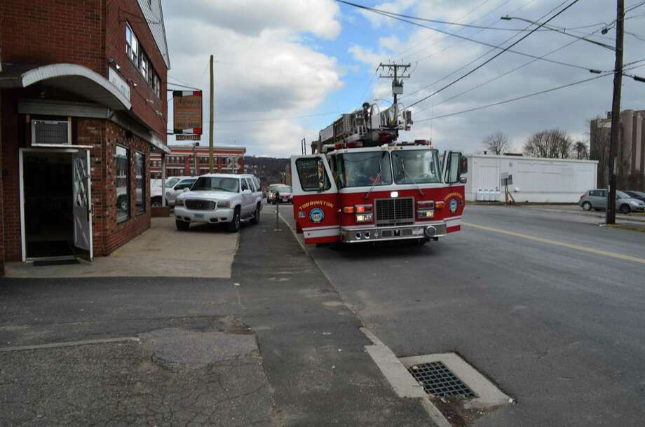 Firefighters were called to a Water Street apartment in Torrington on Monday, Feb. 4, 2013 for a report of smoke. Burnt food caused the smoke condition and led to the evacuation of Alfredo's, located below the apartment.