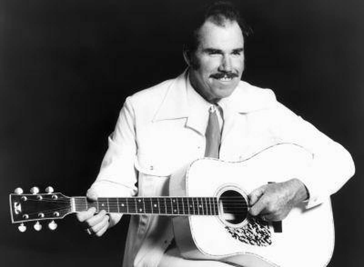 FILE - This undated file photo shows country singer Slim Whitman. Whitman died Wednesday, June 12, 2013 of heart failure in Florida. He was 90. Whitman's career began in the late 1940s, and his tenor falsetto and ebony mustache and sideburns became global trademarks. They were also an inspiration for countless jokes thanks to the ubiquitous 1980s and 1990s TV commercials that pitched his records. (AP Photo, file)