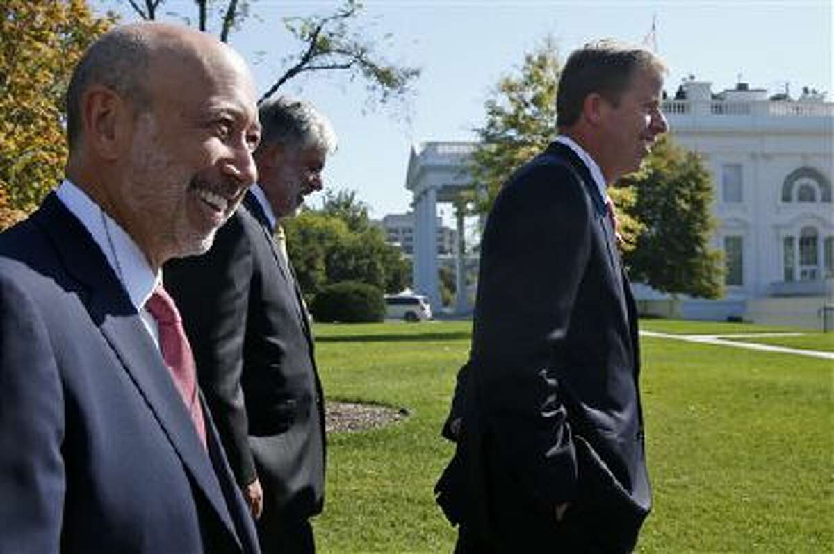From left, The Goldman Sachs Group, Inc. Chairman and CEO Lloyd Blankfein, American International Group President and CEO Robert Benmosche, and GE Capital Chairman and CEO Keith Sherin, and other financial sector leaders arrive at the White House on Oct. 2 for a meeting with President Barack Obama regarding the debt ceiling and the economy.