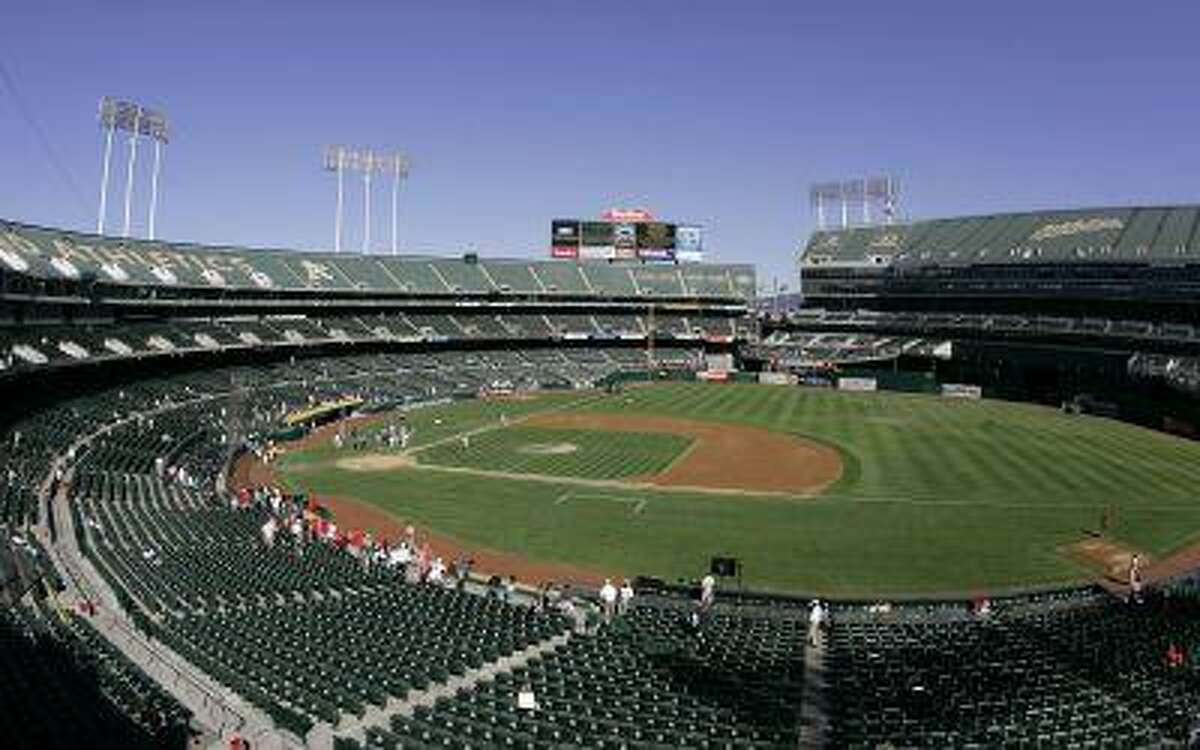 This Sept. 30, 2007 file photo shows O.Co Coliseum, then called McAfee Coliseum, home of the Oakland Athletics baseball team, in Oakland, Calif.