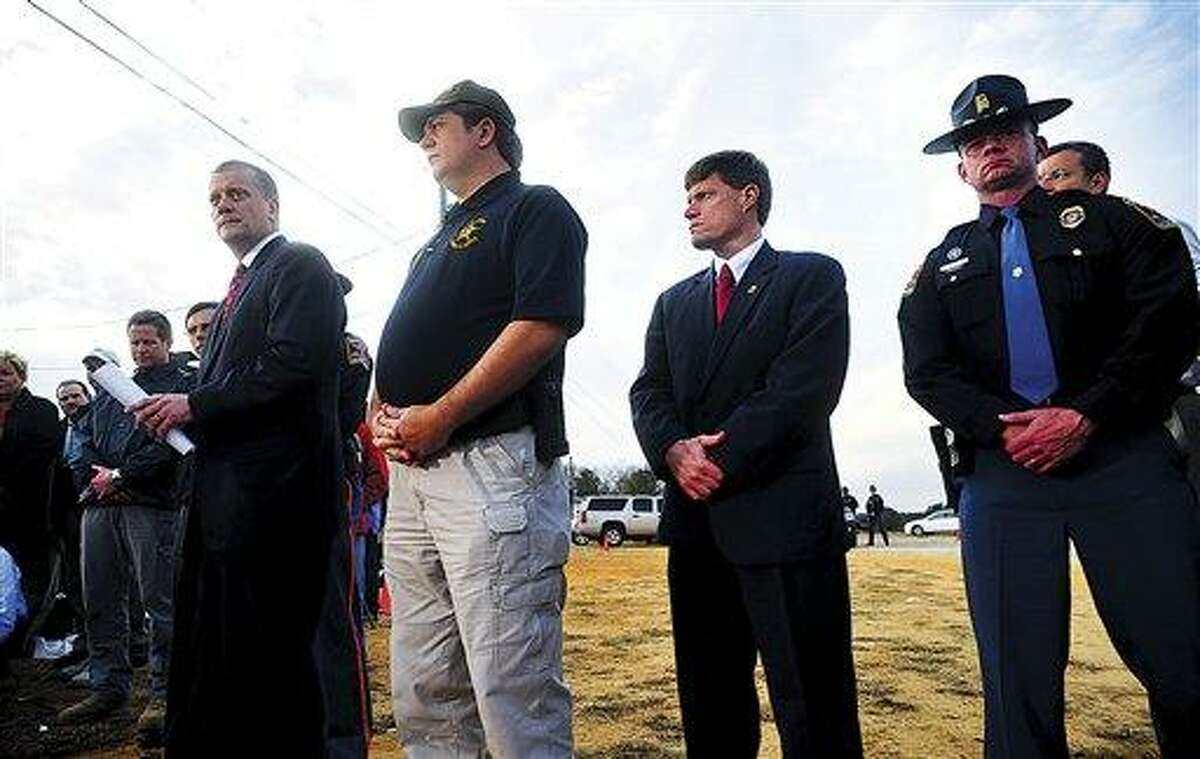 FBI Bureau Chief in Mobile, Steve Richardson, left, gives a statement to the media following the end of the hostage crisis in Midland City, Ala. on Monday afternoon, Feb. 4, 2013. Also pictured are Dale County Sheriff Wally Olsen, Dale County District Attorney Kirk Adams and State Trooper Kevin Cook. (AP Photo/The Dothan Eagle, Jay Hare)