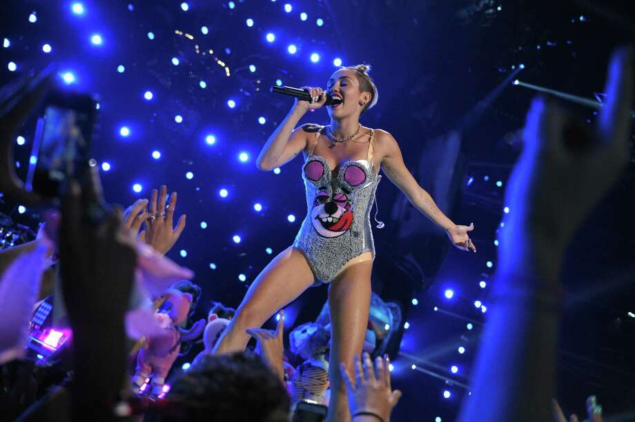 """This image released by MTV shows Miley Cyrus performing at the MTV Video Music Awards at Barclays Center on Sunday, Aug. 25, 2013, in the Brooklyn borough of New York. The """"twerking"""" dance style that Cyrus popularized during this performance is cited among the reasons why a Vermont high school dance was cancelled. (AP Photo/MTV, John Shearer) Photo: AP / MTV"""