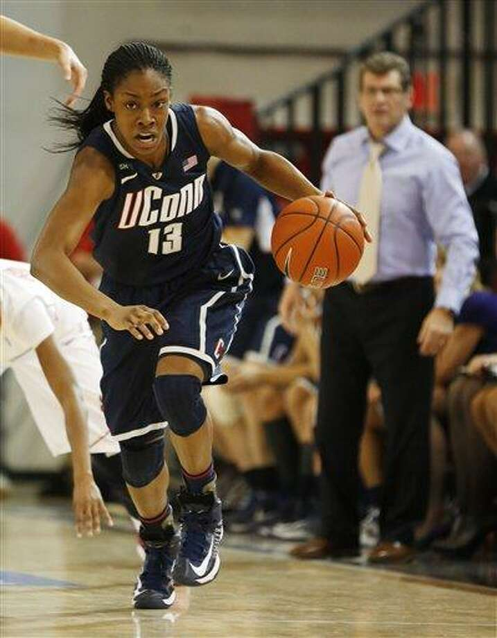 Connecticut guard Brianna Banks (13) breaks away during the first half of a NCAA college basketball game against St. John's, Saturday, Feb. 2, 2013, at St. John's University in New York. (AP Photo/John Minchillo) Photo: ASSOCIATED PRESS / AP2013