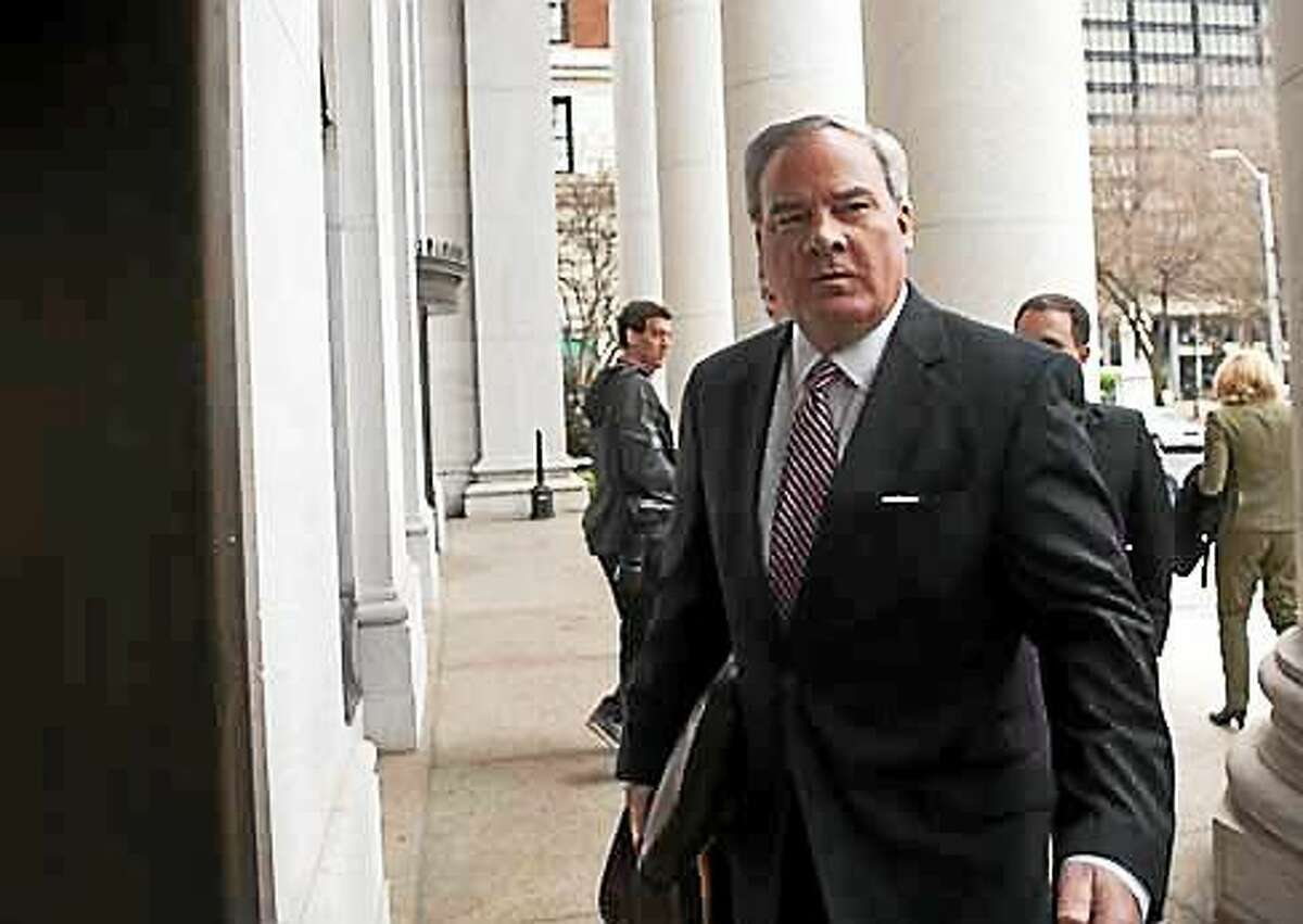 Former Gov. John G. Rowland outside federal court in New Haven Wednesday. His trial is being held in U.S. District Court