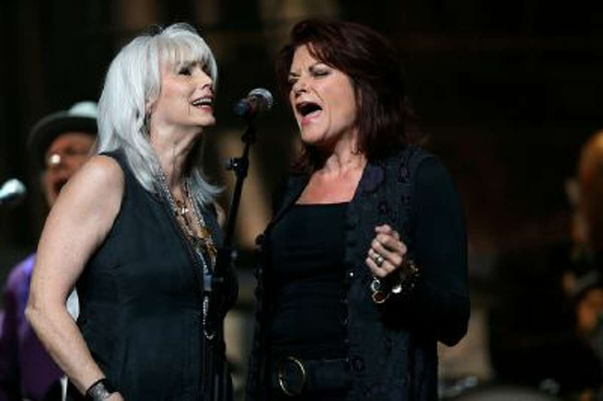 Emmylou Harris, left, and Rosanne Cash perform during the Americana Music Honors and Awards Show on Wednesday, Sept. 18, 2013, in Nashville, Tenn.