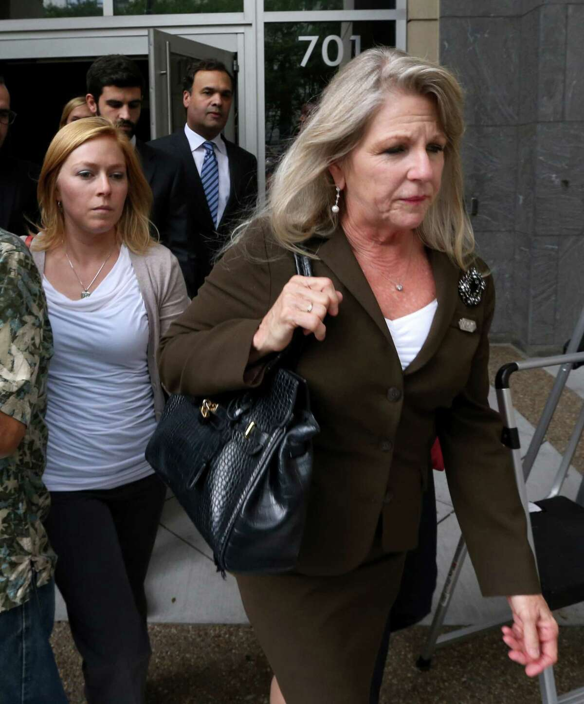 Former Virginia first lady Maureen McDonnell, right, and daughter Cailin Young, left, leave the federal courthouse in Richmond, Va., Thursday, Sept. 4, 2014.