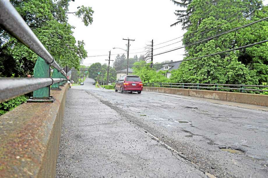 A car drives over the Holabird Avenue bridge in Winsted on Thursday, June 13. Photo: Tom Caprood—Register Citizen
