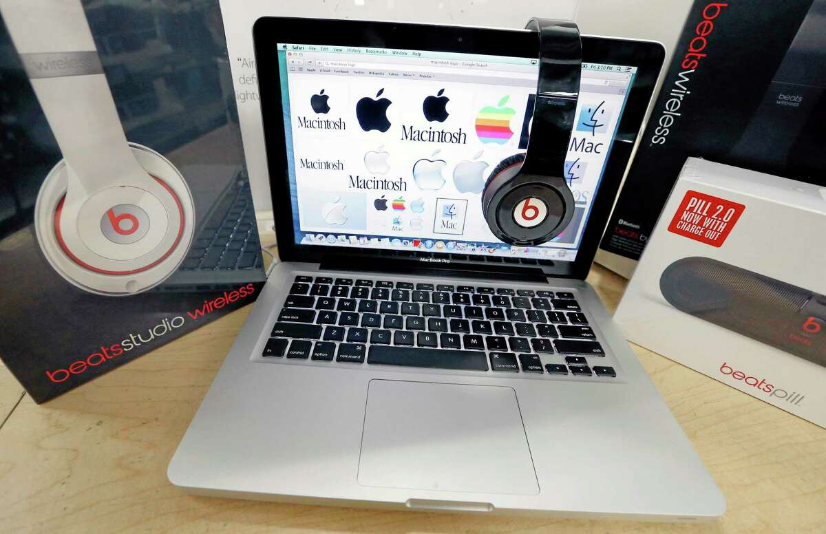 Beats Audio equipment is arranged for a photo next to an Apple laptop at Best Buy in Boston Friday.