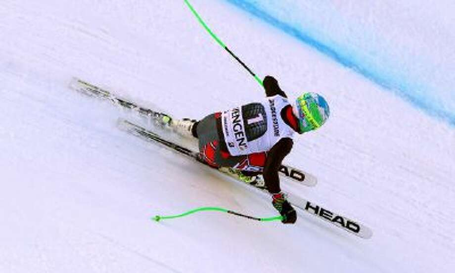 Ted Ligety, of the United States, competes on his way to win an alpine ski, men's World Cup super-combined, in Wengen, Switzerland, Friday.