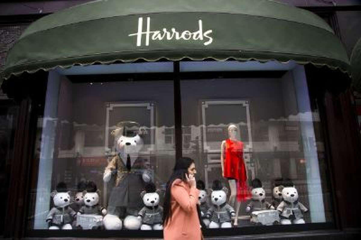 Dior teddybears are seen in a window display at Harrods on March 18, 2013 in London, England.