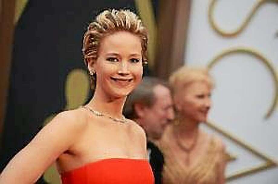 In this March 2, 2014 file photo, Jennifer Lawrence arrives at the Oscars at the Dolby Theatre in Los Angeles. Photo: (Jordan Strauss — The Associated Press)