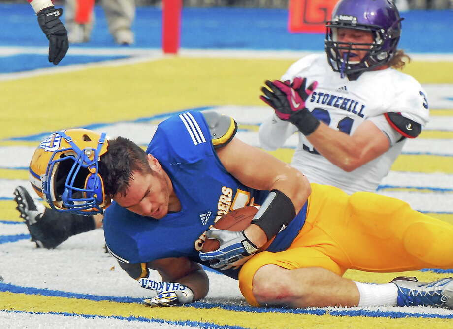 New Haven tight end Michael Flacco's helmet flies off after catching a touchdown pass during the Chargers' Oct. 19, 2013, game against Stonehill. Photo: Mara Lavitt — Register File Photo  / Mara Lavitt