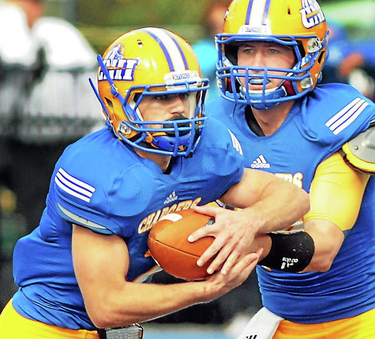 New Haven running back Mike DeCaro takes the handoff from Chargers quarterback Ronnie Nelson during the Chargers' Oct. 19, 2013, game against Stonehill.