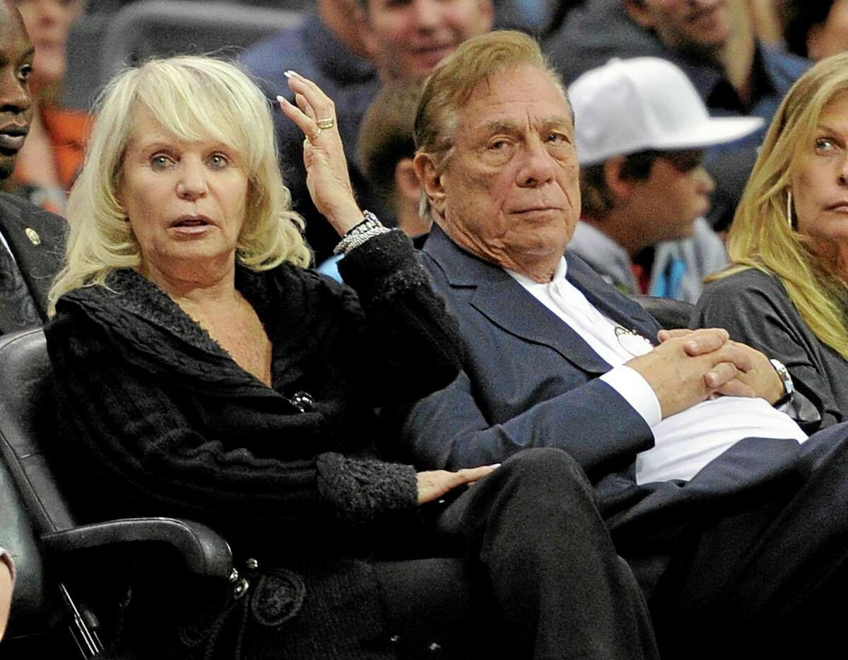 In this Nov. 12, 2010, file photo, Clippers owner Donald Sterling, right, sits with his wife Shelly during a game against the Detroit Pistons in Los Angeles. An attorney representing her said Thursday that she will fight to retain her 50 percent ownership stake in the team.