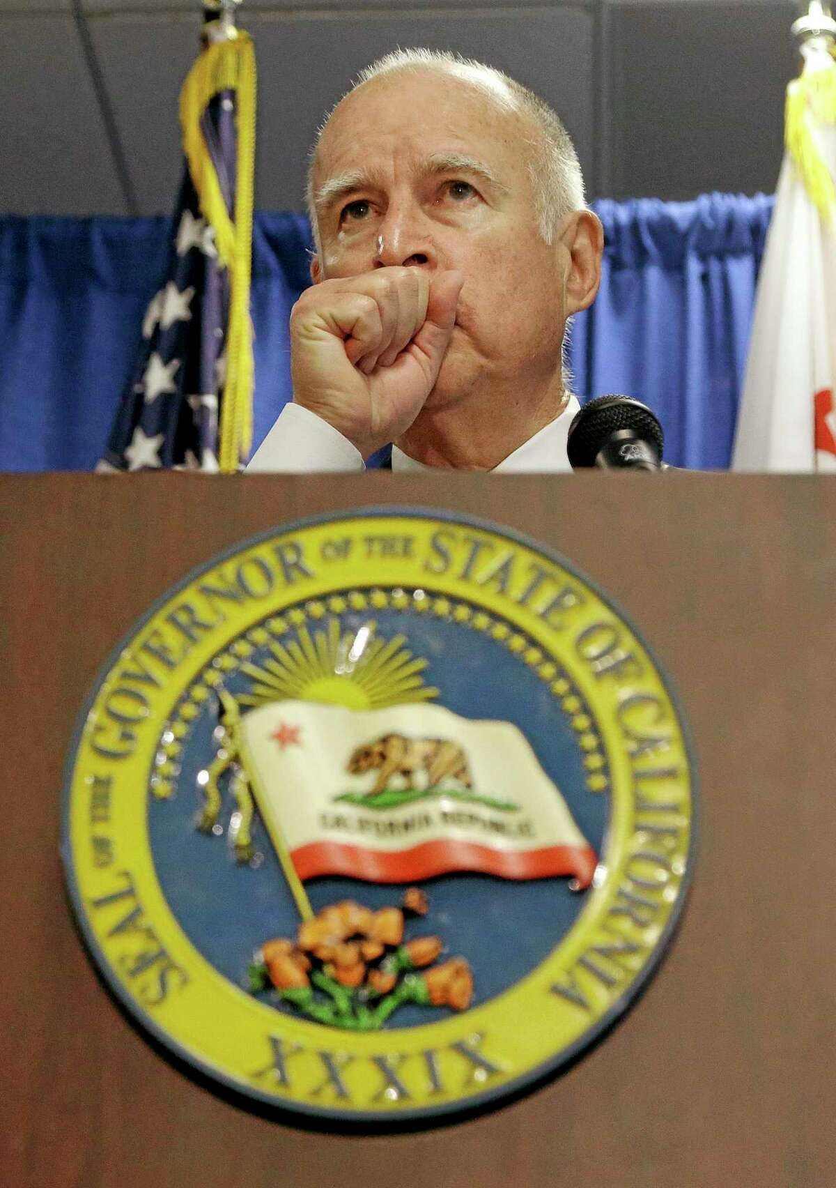 Gov. Jerry Brown pauses while declaring drought state of emergency in San Francisco, Friday, Jan. 17, 2014. With a record-dry year, reservoir levels under strain and no rain in the forecast, California Gov. Jerry Brown formally proclaimed the state in a drought Friday, confirming what many already knew. Brown made the announcement in San Francisco amid increasing pressure in recent weeks from the state's lawmakers, including Democratic Sen. Dianne Feinstein. (AP Photo/Jeff Chiu)