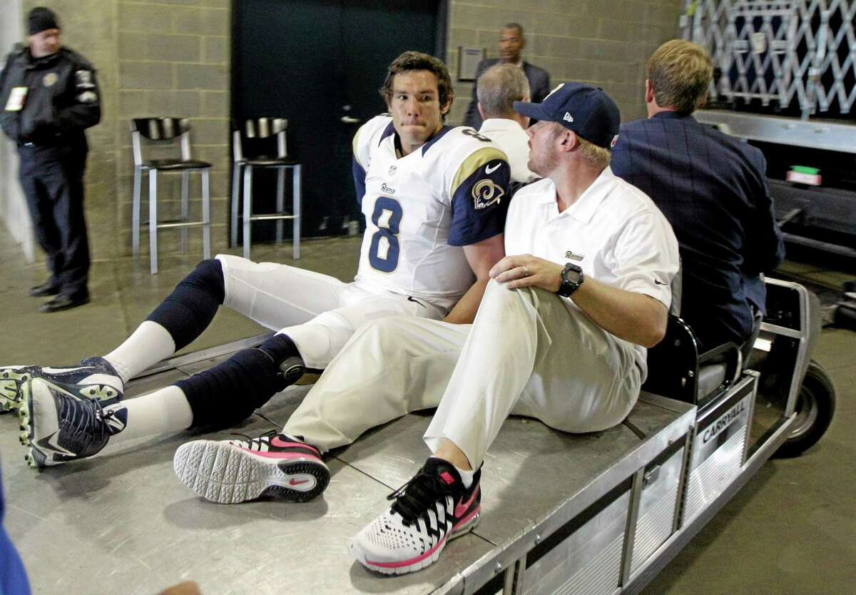 St. Louis Rams quarterback Sam Bradford is taken to the locker room after being injured in the second half of Sunday's game against the Carolina Panthers in Charlotte, N.C. Bradford will miss the rest of the season because of a torn knee ligament.