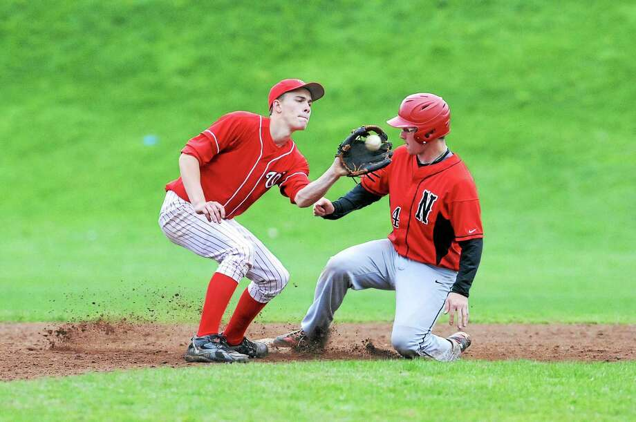 Laurie Gaboardi Register Citizen Northwestern's Zach Risedorf slides safely into second base in the Highlanders' 11-8 win over Wamogo. Photo: Journal Register Co.
