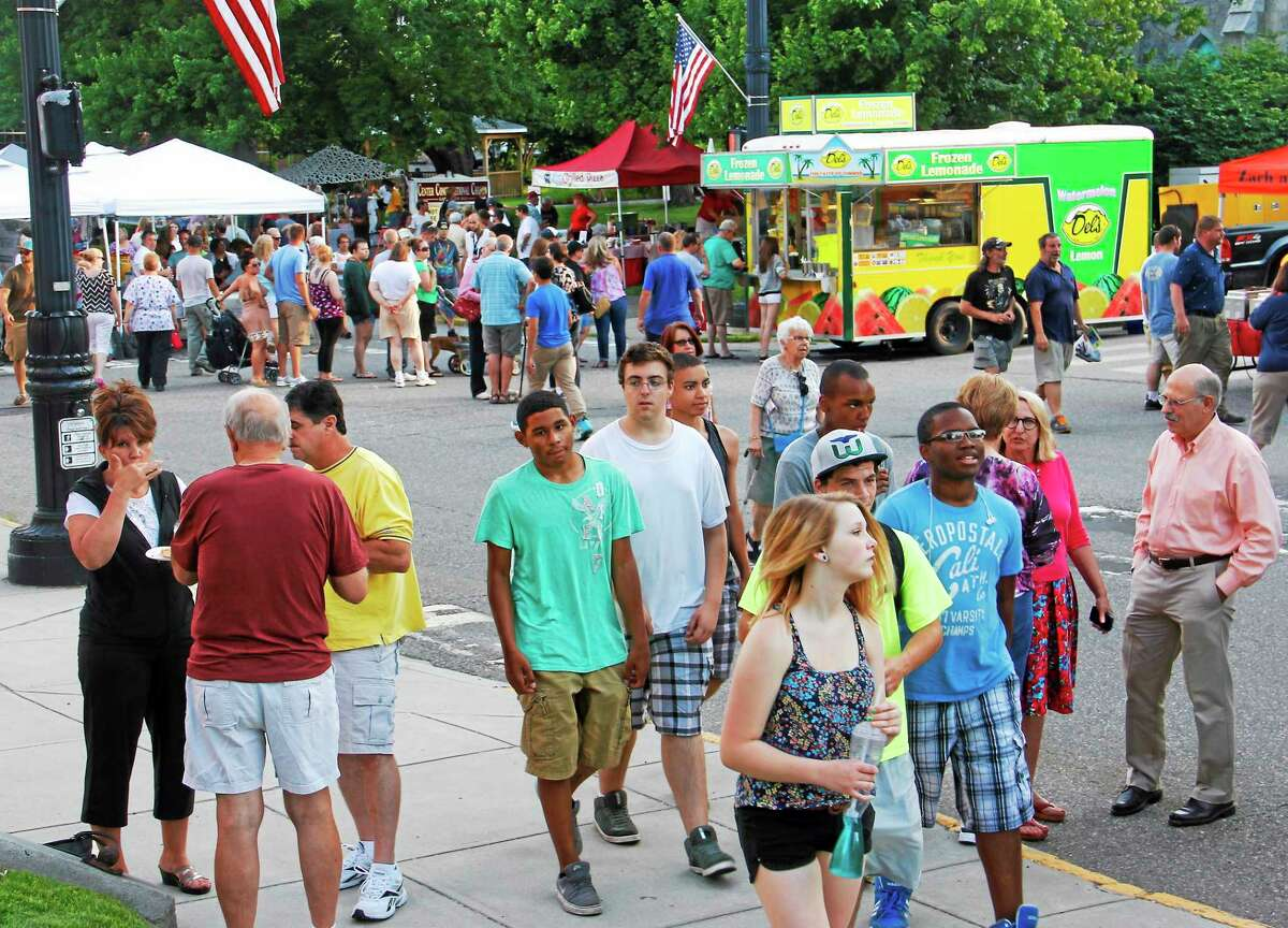 Crowds line Main Street in downtown Torrington during Main Street Marketplace July 10.
