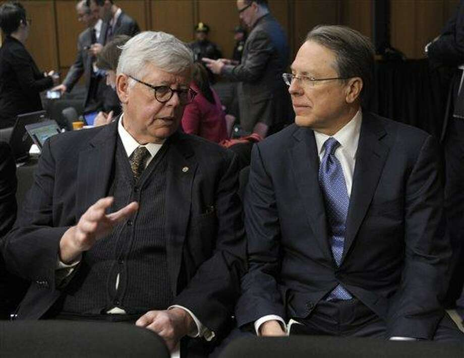 National Rifle Association President David Keene, left, talks with NRA Chief Executive Officer Wayne LaPierre, right, on Capitol Hill in Washington, Wednesdaybefore the start of the Senate Judiciary Committee hearing on gun violence. Supporters and opponents of stricter gun control measures faced off at a hearing on what lawmakers should do to curb gun violence in the wake of last month's shooting rampage in Newtown, Ct., that killed 20 schoolchildren. AP Photo/Susan Walsh Photo: AP / AP