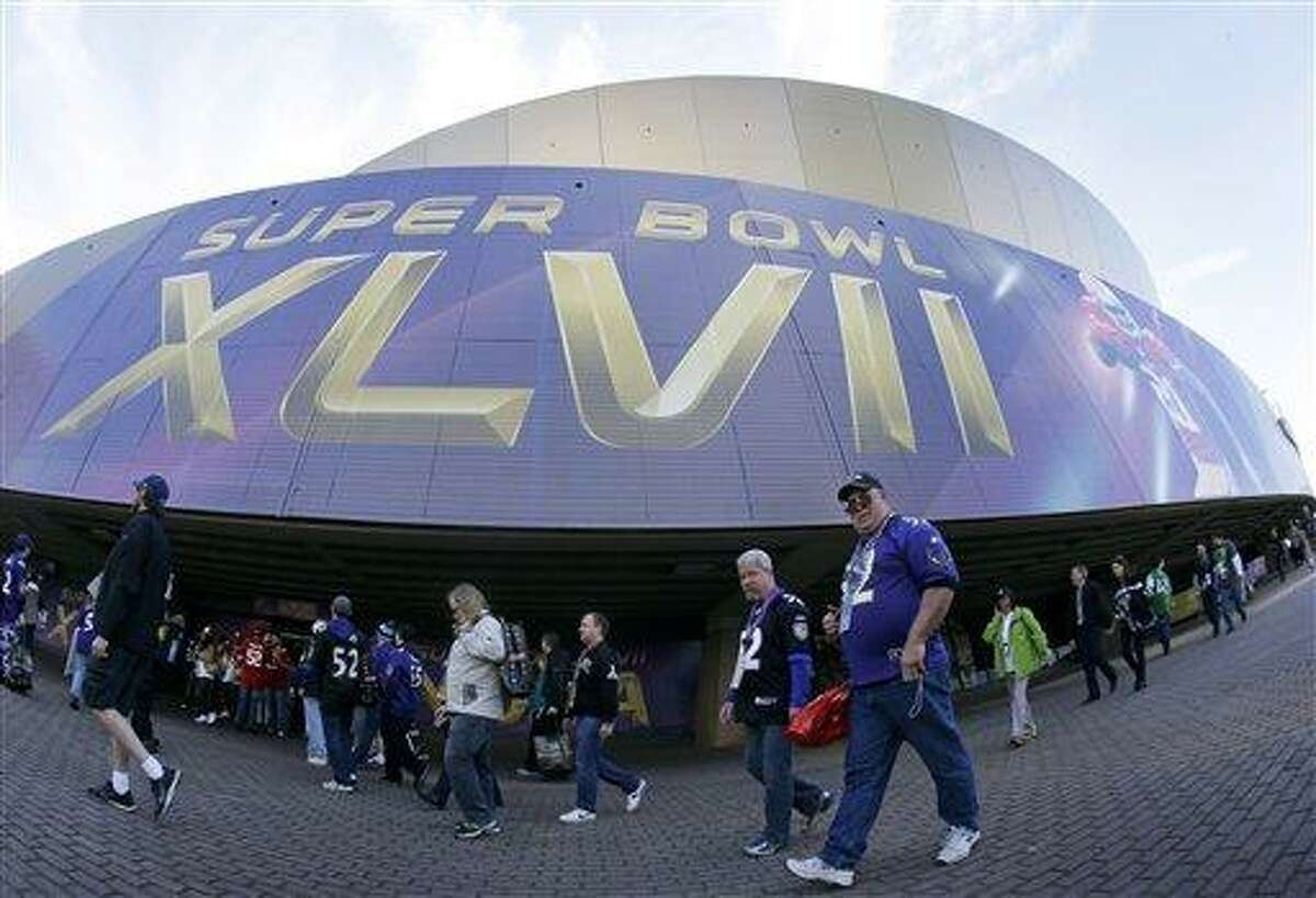 Fans walk outside the Superdome before the NFL Super Bowl XLVII football game between the San Francisco 49ers and the Baltimore Ravens Sunday, Feb. 3, 2013, in New Orleans. (AP Photo/Mark Humphrey)