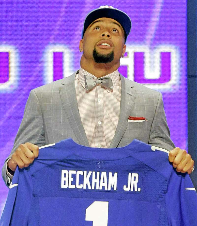 LSU wide receiver Odell Beckam Jr. looks skyward after being selected by the New York Giants as the 12th pick overall in the first round of the NFL Draft on Thursday. Photo: Frank Franklin — The Associated Press  / AP