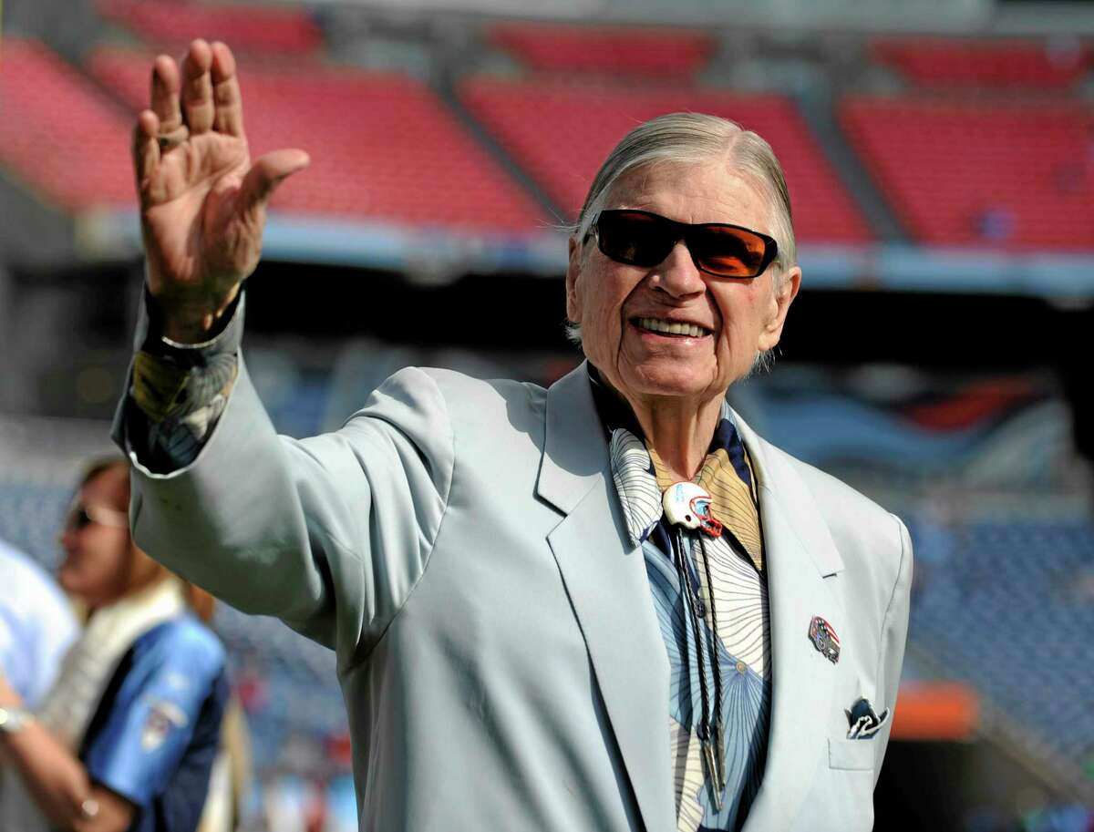"In this Oct. 24, 2010 file photo, Tennessee Titans owner K.S. ""Bud"" Adams Jr. waves to fans before a game against the Philadelphia Eagles in Nashville, Tenn. The team announced Monday that Adams had died in Houston home, saying he ""passed away peacefully from natural causes."""