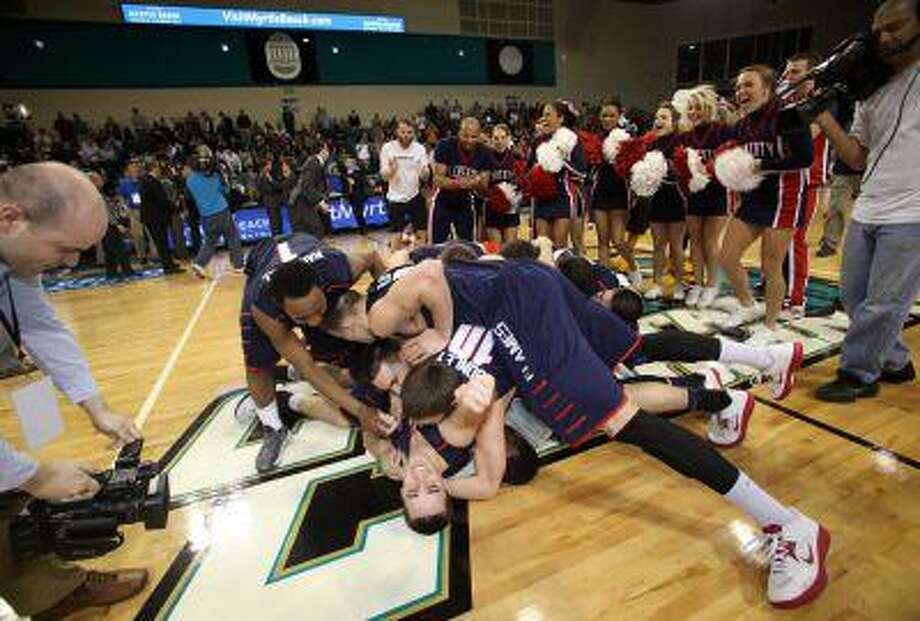Liberty players celebrate at mid-court after defeating Charleston Southern 87-76 in an NCAA college basketball game in the championship at the Big South Conference tournament on Sunday March 10, 2013 in Conway, S.C. Photo: ASSOCIATED PRESS / AP2013