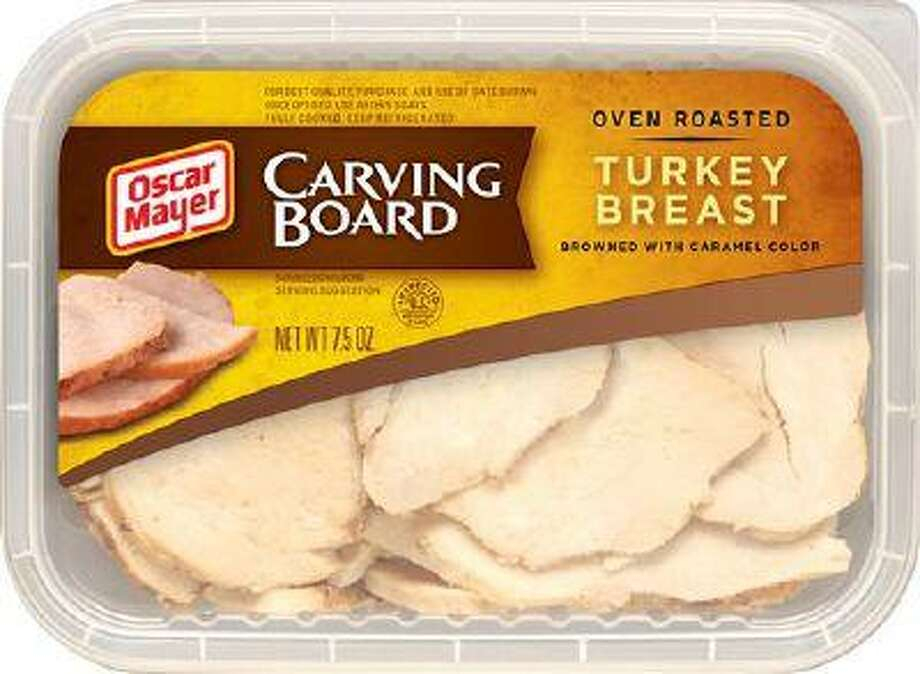 In this undated photo provided by Kraft Foods Inc., a package of Oscar Mayer Carving Board Turkey Breast is shown. More companies are now trying to make processed foods appear more homespun. (AP Photo/Kraft Foods Inc.) Photo: AP / Kraft Foods Inc.