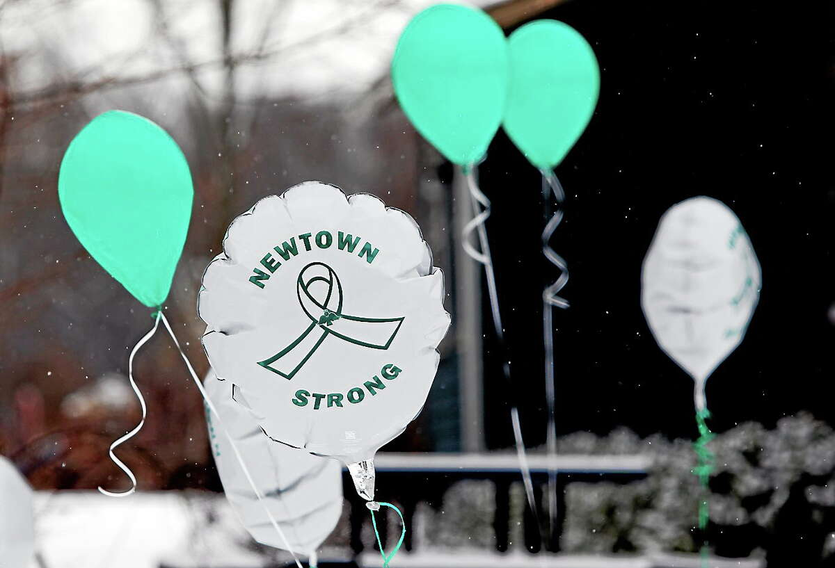 Balloons fly outside a doctor's office on the first anniversary of the Sandy Hook massacre, in Newtown, Conn. on Dec. 14, 2013.