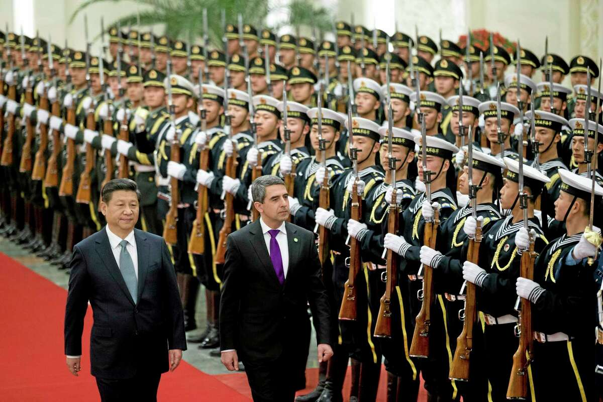 Chinese President Xi Jinping, left, and Bulgarian President Rossen Plevneliev review an honor guard during a welcome ceremony at the Great Hall of the People in Beijing, Monday, Jan. 13, 2014. (AP Photo/Alexander F. Yuan)